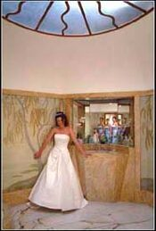 bride with bridesmaids reflected in mirror